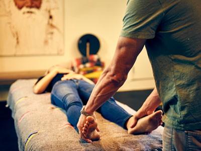 Online Breathwork Teacher Training - Jon Paul Crimi holding feet during breathwork training